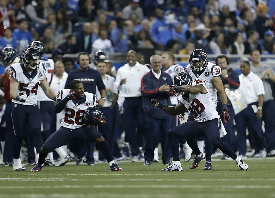 Houston Texans free safety Danieal Manning (38), right, celebrates causing Detroit Lions tight end Brandon Pettigrew (87) to fumble with Houston Texans defensive back Brandon Harris (26) in overtime of an NFL football game in Detroit, Thursday, Nov. 22, 2012. Houston won 34-31. (AP Photo/Paul Sancya) Photo: Paul Sancya, Associated Press