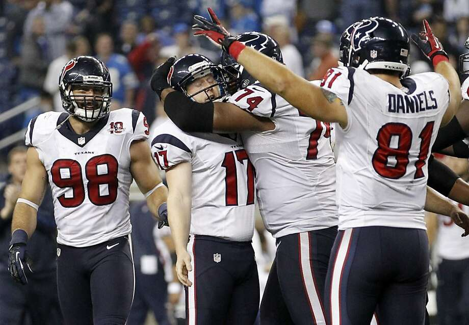 Houston Texans kicker Shayne Graham (17) is mobbed by teammates Wade Smith (74) and Owen Daniels (81) after kicking the game-winning field goal in overtime of an NFL football game against the Detroit Lions at Ford Field in Detroit, Thursday, Nov. 22, 2012. Looking on at left is Connor Barwin. The Texans won 34-31. (AP Photo/Rick Osentoski) Photo: Rick Osentoski, Associated Press