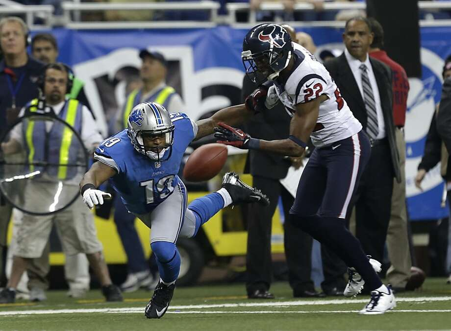 Houston Texans defensive back Alan Ball (22) defends Detroit Lions wide receiver Mike Thomas in the second half of an NFL football game in Detroit, Thursday, Nov. 22, 2012. Houston won 34-31. (AP Photo/Paul Sancya) Photo: Paul Sancya, Associated Press