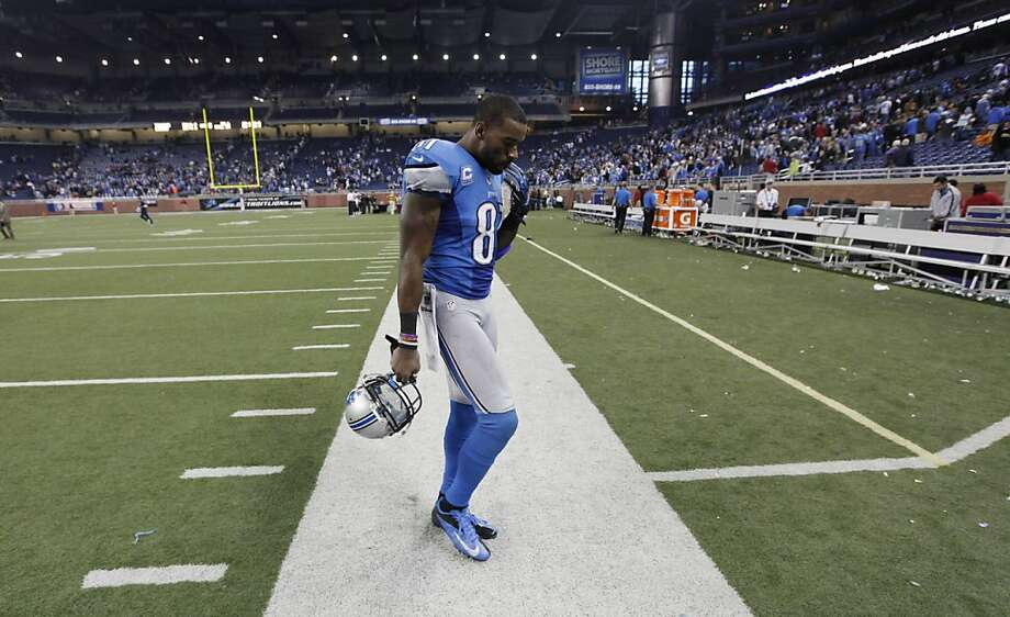 Detroit Lions wide receiver Calvin Johnson (81) walks off the field after the Lions' 34-31 loss to the Houston Texans in overtime of an NFL football game at Ford Field in Detroit, Thursday, Nov. 22, 2012. (AP Photo/Paul Sancya) Photo: Paul Sancya, Associated Press