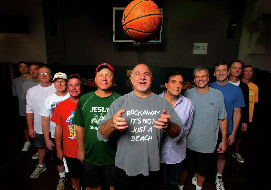 John Connolly, center, and other members of Fat Dads Basketball team, raised $13,000 to aid  Hurricane Sandy victims. Photo: Billy Smith II, Staff / © 2012 Houston Chronicle