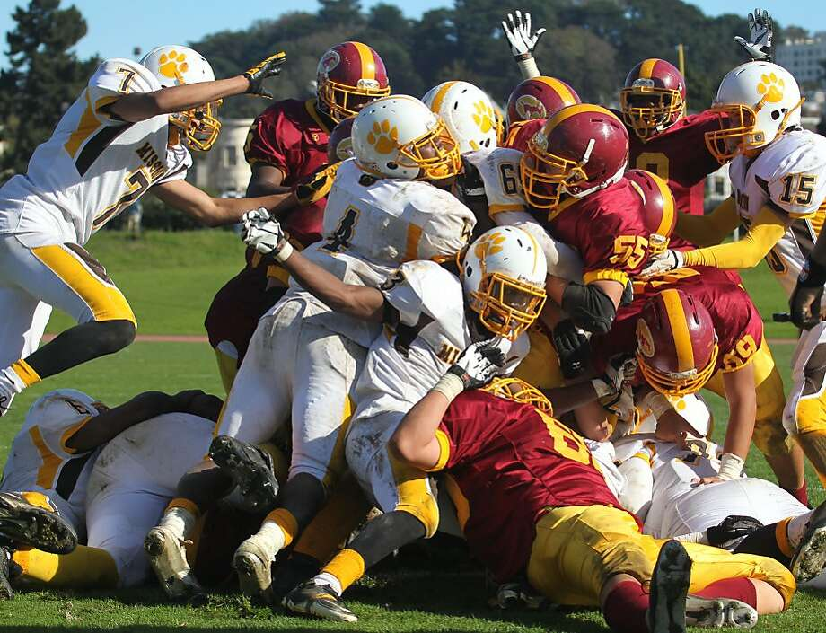 "Lincoln's Demetrius Williams (6) is lost in the pile on the goalline late into their game with  the Mission Bears at Kezar Stadium The Lincoln Mustangs played the Mission Bears in the annual AAA/SF Section Varsity Football ""Turkey Day"" championship game in San Francisco Thursday Nov. 22, 2012.Lincoln won 22-21 Photo: Lance Iversen, The Chronicle"