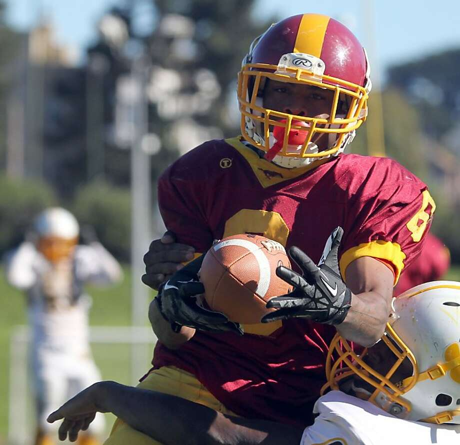 "Lincoln's Demetrius Williams scores on a 26 yard touchdown run against the Mustang's in the second quarter at Kezar Stadium. The Lincoln Mustangs played the Mission Bears in the annual AAA/SF Section Varsity Football ""Turkey Day"" championship game in San Francisco Thursday Nov. 22, 2012. Lincoln won 22-21 Photo: Lance Iversen, The Chronicle"