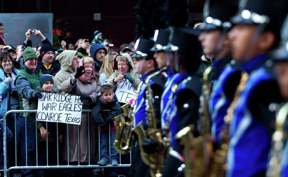 Fans of the Oak Ridge High School Marching Band cheer as the band marches past them on 6th Avenue during the Macy's Thanksgiving Day Parade Thursday, Nov. 22, 2012, in New York City. Photo: Brett Coomer, Houston Chronicle / © 2012 Houston Chronicle