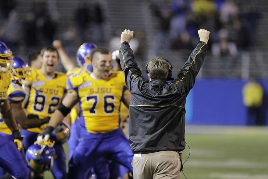 Coach Mike MacIntyre (right) celebrates a 4th-and-goal stop in the fourth quarter against BYU. Photo: John Storey, Associated Press