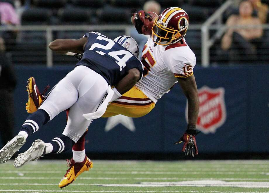 Morris Claiborne #24 of the Dallas Cowboys makes the tackle against Josh Morgan #15 of the Washington Redskins on Thanksgiving Day at Cowboys Stadium on November 22, 2012 in Arlington, Texas. Photo: Tom Pennington, Getty Images / 2012 Getty Images