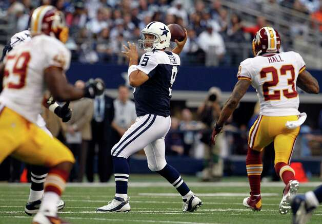 Tony Romo #9 of the Dallas Cowboys looks for an open receiver under pressure against the Washington Redskins on Thanksgiving Day at Cowboys Stadium on November 22, 2012 in Arlington, Texas. Photo: Tom Pennington, Getty Images / 2012 Getty Images
