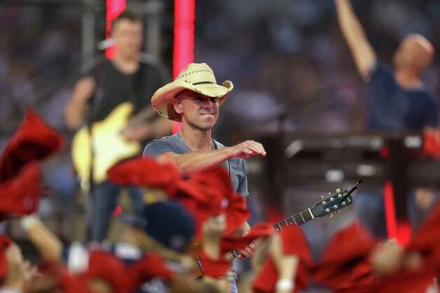 Kenny Chesney performs during the halftime of a Thanksgiving Day game between the Washington Redskins and the Dallas Cowboys at Cowboys Stadium on November 22, 2012 in Arlington, Texas. Photo: Ronald Martinez, Getty Images / 2012 Getty Images