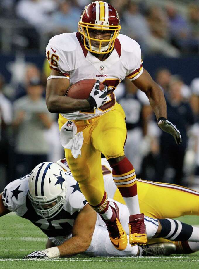 Alfred Morris #46 of the Washington Redskins carries the ball against the Dallas Cowboys on Thanksgiving Day at Cowboys Stadium on November 22, 2012 in Arlington, Texas. Photo: Tom Pennington, Getty Images / 2012 Getty Images