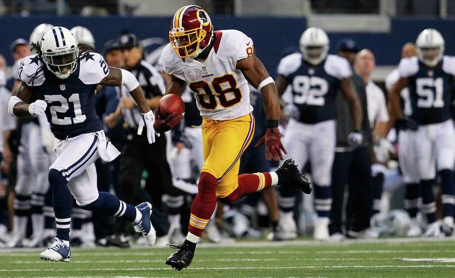Pierre Garcon #88 of the Washington Redskins carries the ball to score a touchdown against Mike Jenkins #21 of the Dallas Cowboys on Thanksgiving Day at Cowboys Stadium on November 22, 2012 in Arlington, Texas. Photo: Tom Pennington, Getty Images / 2012 Getty Images