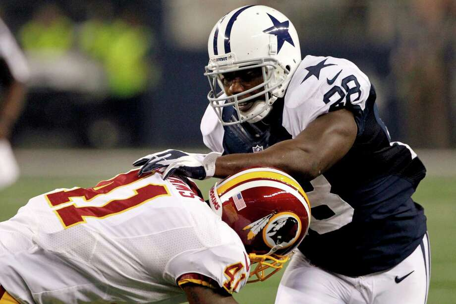 Washington Redskins free safety Madieu Williams (41) tackles Dallas Cowboys' Felix Jones (28) in the second half of an NFL football game, Thursday, Nov. 22, 2012, in Arlington, Texas. (AP Photo/Tim Sharp) Photo: Tim Sharp, Associated Press / FR62992 AP