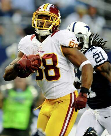 Washington Redskins wide receiver Pierre Garcon (88) outruns Dallas Cowboys' Mike Jenkins (21) as he heads for the end zone for a touchdown in the first half of an NFL football game, Thursday, Nov. 22, 2012, in Arlington, Texas. (AP Photo/Matt Strasen) Photo: Matt Strasen, Associated Press / FR170476 AP