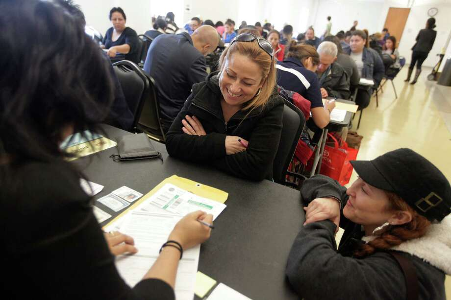 Lisbet Guerrero, of Cuba, gets help in filling out the citizenship form during a citizenship and immigration session at Hiram Clarke Multi-Service Center. Photo: Mayra Beltran, Staff / © 2012 Houston Chronicle