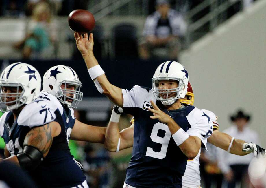Dallas Cowboys quarterback Tony Romo (9) passes as Nate Livings (71) helps against pressure in the second half of an NFL football game against the Washington Redskins, Thursday, Nov. 22, 2012, in Arlington, Texas. (AP Photo/Tim Sharp) Photo: Tim Sharp, Associated Press / FR62992 AP