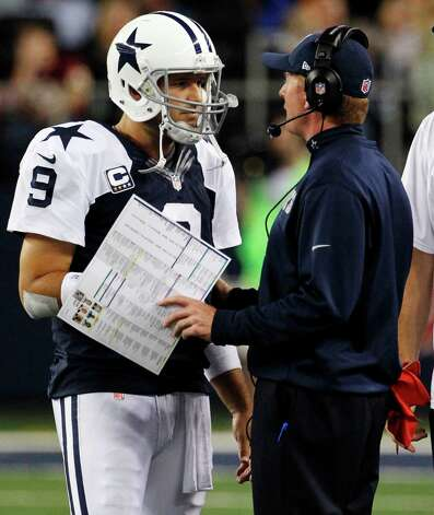 Dallas Cowboys quarterback Tony Romo (9) talks to head coach Jason Garrett early in the second half of an NFL football game against the Washington Redskins, Thursday, Nov. 22, 2012, in Arlington, Texas. (AP Photo/Tim Sharp) Photo: Tim Sharp, Associated Press / FR62992 AP