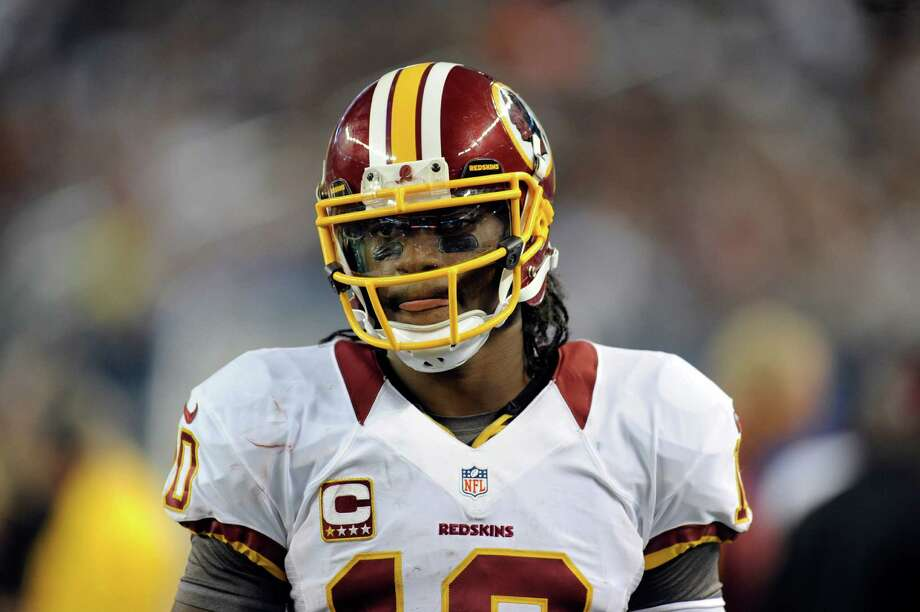 Washington Redskins quarterback Robert Griffin III (10) stands on the sideline early in the second half of an NFL football game against the Dallas Cowboys Thursday, Nov. 22, 2012 in Arlington, Texas. (AP Photo/Matt Strasen) Photo: Matt Strasen, Associated Press / FR170476 AP