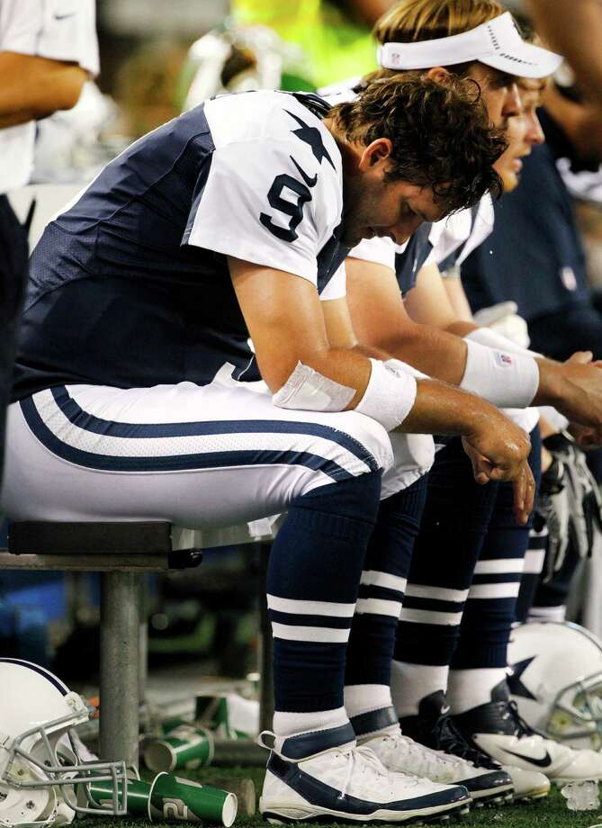 Dallas Cowboys quarterback Tony Romo (9) sits on the bench in the second half of an NFL football game against the Washington Redskins, Thursday, Nov. 22, 2012, in Arlington, Texas. (AP Photo/Tim Sharp) Photo: Tim Sharp, Associated Press / FR62992 AP