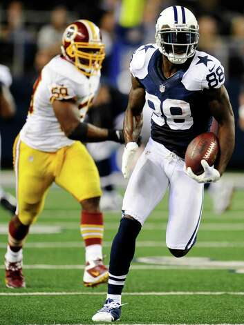 Dallas Cowboys wide receiver Dez Bryant (88) sprints for the end zone to score a touchdown after a reception as Washington Redskins' London Fletcher (59) gives chase in the second half of an NFL football game, Thursday, Nov. 22, 2012, in Arlington, Texas. (AP Photo/Matt Strasen) Photo: Matt Strasen, Associated Press / FR170476 AP