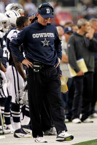 Dallas Cowboys head coach Jason Garrett kicks at the ground late in the first half of an NFL football game against the Washington Redskins, Thursday, Nov. 22, 2012, in Arlington, Texas. (AP Photo/Tim Sharp) Photo: Tim Sharp, Associated Press / FR62992 AP