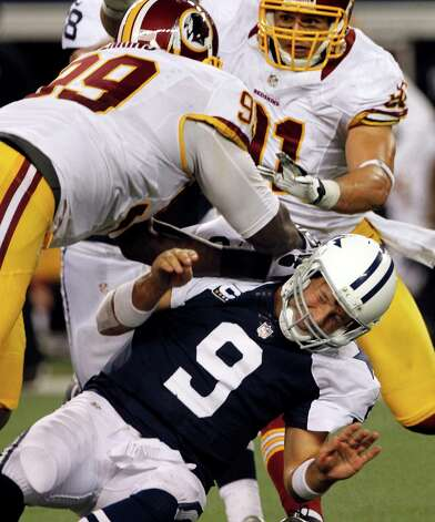Dallas Cowboys quarterback Tony Romo (9) is knocked to the ground by Washington Redskins' Jarvis Jenkins (99) with help from Ryan Kerrigan, rear, in the second half of an NFL football game, Thursday, Nov. 22, 2012, in Arlington, Texas. (AP Photo/Tim Sharp) Photo: Tim Sharp, Associated Press / FR62992 AP