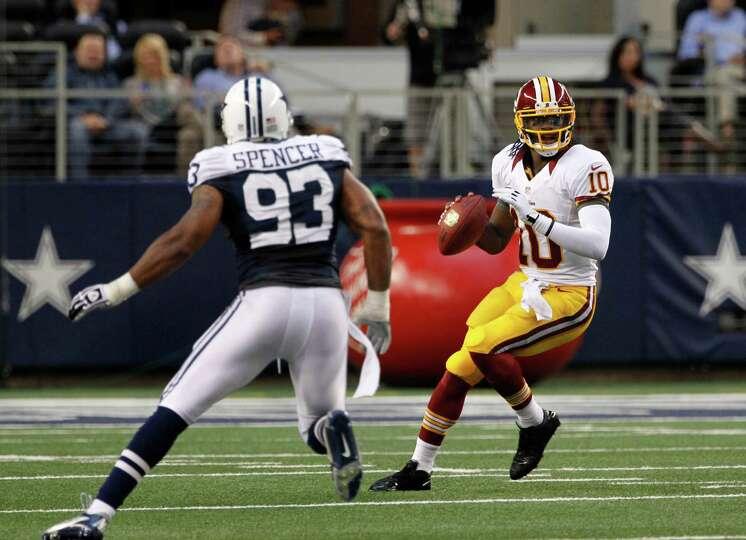 Dallas Cowboys outside linebacker Anthony Spencer (93) pressures as Washington Redskins' Robert G