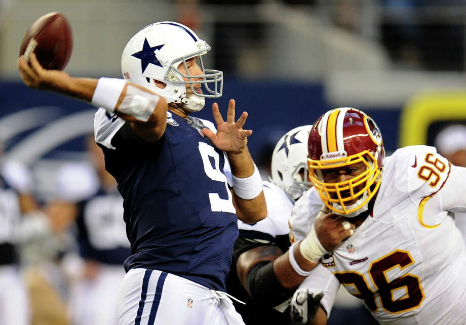 Dallas Cowboys quarterback Tony Romo (9) passes under pressure from Washington Redskins' Barry Cofield (96) in the first half of an NFL football game, Thursday, Nov. 22, 2012, in Arlington, Texas. (AP Photo/Matt Strasen) Photo: Matt Strasen, Associated Press / FR170476 AP