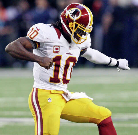 Washington Redskins' Robert Griffin III celebrates after the Redskins scored a touchdown against the Dallas Cowboys during first half action Thursday Nov. 22, 2012 at Cowboys Stadium in Arlington, Tx. Photo: Edward A. Ornelas, Express-News / © 2012 San Antonio Express-News