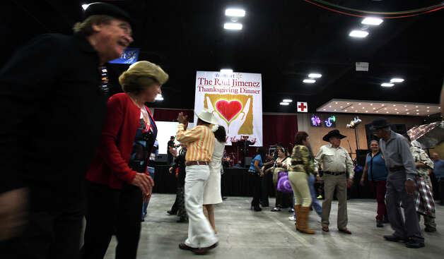 Holiday cheer can be seen on the dance floor at the Raul Jimenez Thanksgiving Dinner at the Henry B. Gonzalez Convention Center, Thursday, Nov. 22, 2012. Photo: Bob Owen, San Antonio Express-News / © 2012 San Antonio Express-News