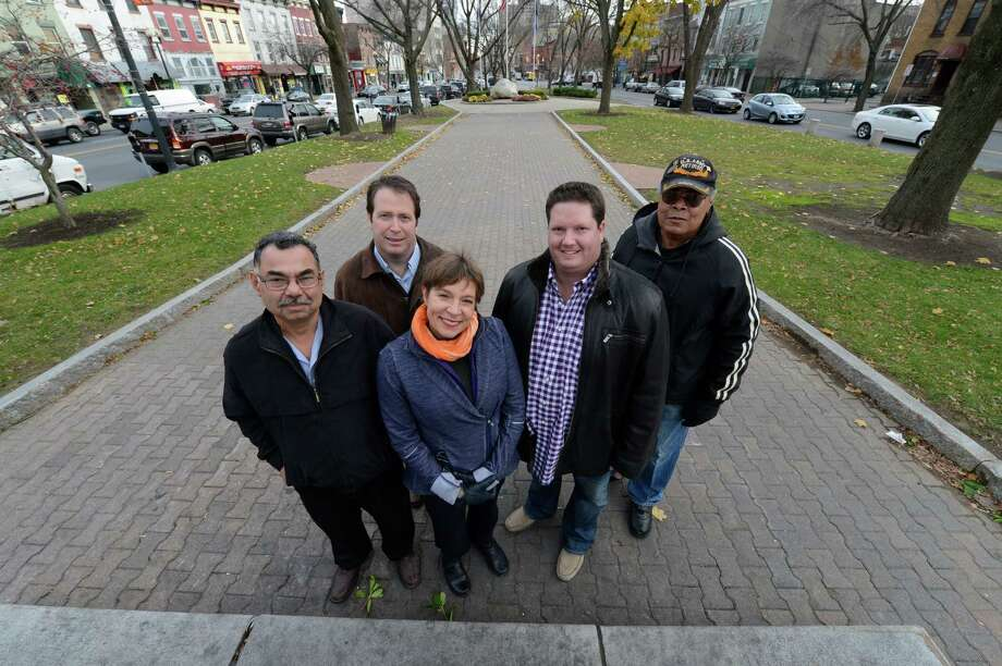 Local business owners gather in Townsend Park in Albany, N.Y. Nov 15, 2012 to speak to the Times Union about the improvement in the park since its cleanup and removal of park benches.  The business owners are;  Saleem Kahn, Aashiana Restaurant, left;  Daniel Sanders, Harris A. Sanders Architects, second from left;  Casey Berstein, The Center Nia & Yoga, center;  Adam Gelman, Subway&Taco Del Mar, second from right and Ron Scott, president Townsend Park Tenant Association.      (Skip Dickstein/Times Union) Photo: Skip Dickstein / 00020153A