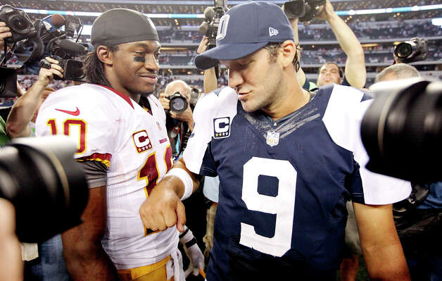 Washington Redskins' Robert Griffin III and Dallas Cowboys' Tony Romo talk after the game Thursday Nov. 22, 2012 at Cowboys Stadium in Arlington, Tx.  The Redskins won 38-31. Photo: Edward A. Ornelas, San Antonio Express-News / © 2012 San Antonio Express-News