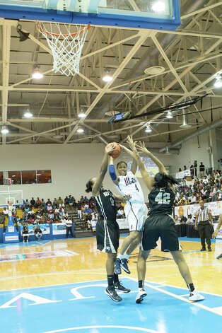 University of Connecticut's Moriah Jefferson #4  gets double teamed during the Paradise Jam women's college basketball tournament in St. Thomas, US Virgin Islands, Thursday, Nov. 22, 2012 (Photo/Thomas Layer) Photo: Courtesy Of Thomas Layer / Connecticut Post contributor