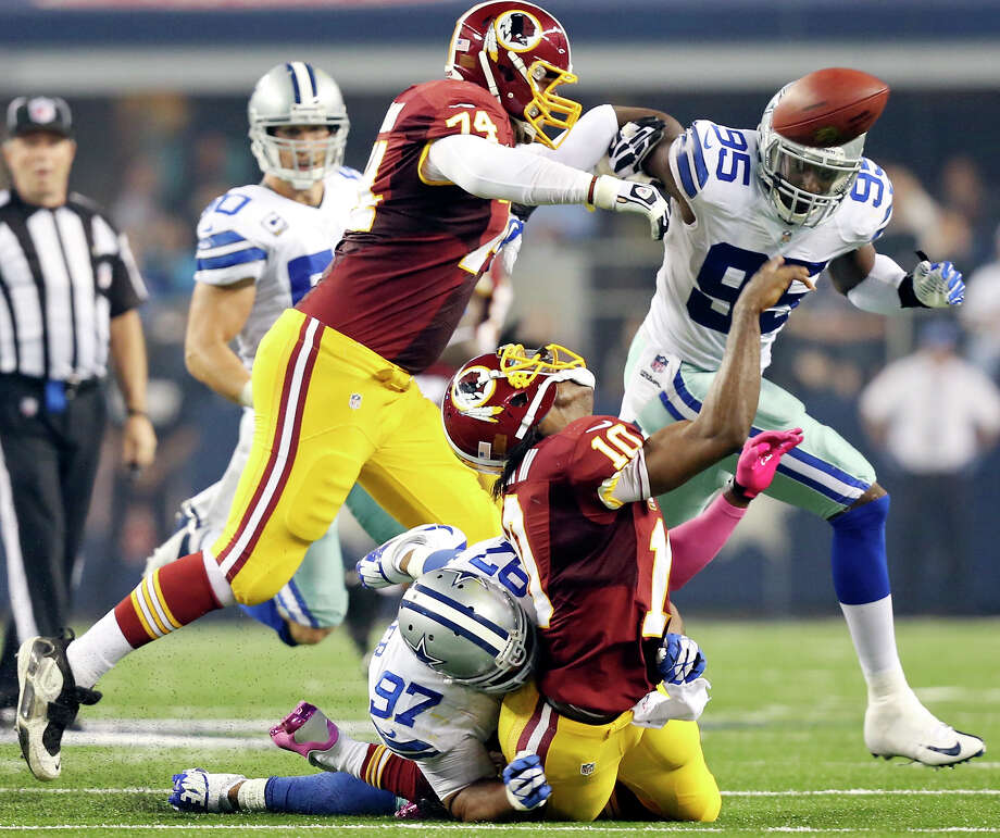 Dallas Cowboys' Jason Hatcher sacks Washington Redskins' Robert Griffin III as he tries to pass during first half action Sunday Oct. 13, 2013 at AT&T Stadium in Arlington, Tx. Photo: Edward A. Ornelas, San Antonio Express-News / © 2012 San Antonio Express-News