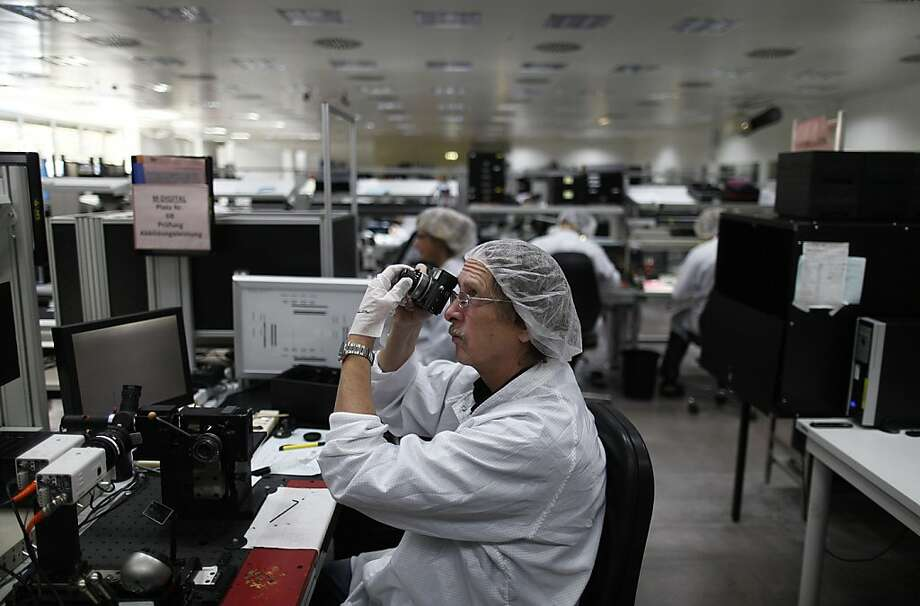 A technician checks the viewfinder function of a Leica M series digital camera at the Leica Camera AG headquarters in Solms, Germany, on Wednesday, Oct. 31, 2012. Leica's compact cameras, introduced in the 1920s were developed by German optical engineer Oskar Barnack, who had worked in microscope research and was employed by an optician called Ernst Leitz in Wetzlar, Germany. Photographer: Simon Dawson/Bloomberg Photo: Simon Dawson, Bloomberg