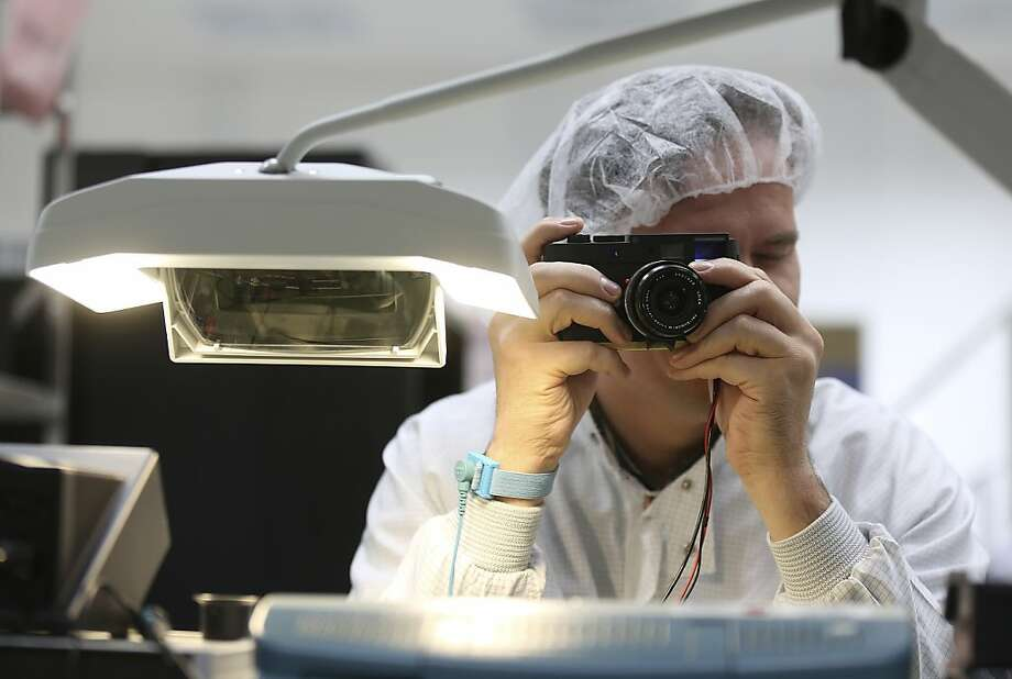 A technician tests a Leica M series digital camera during the assembly process at the Leica Camera AG headquarters in Solms, Germany, on Wednesday, Oct. 31, 2012. Leica's compact cameras, introduced in the 1920s were developed by German optical engineer Oskar Barnack, who had worked in microscope research and was employed by an optician called Ernst Leitz in Wetzlar, Germany. Photographer: Simon Dawson/Bloomberg Photo: Simon Dawson, Bloomberg
