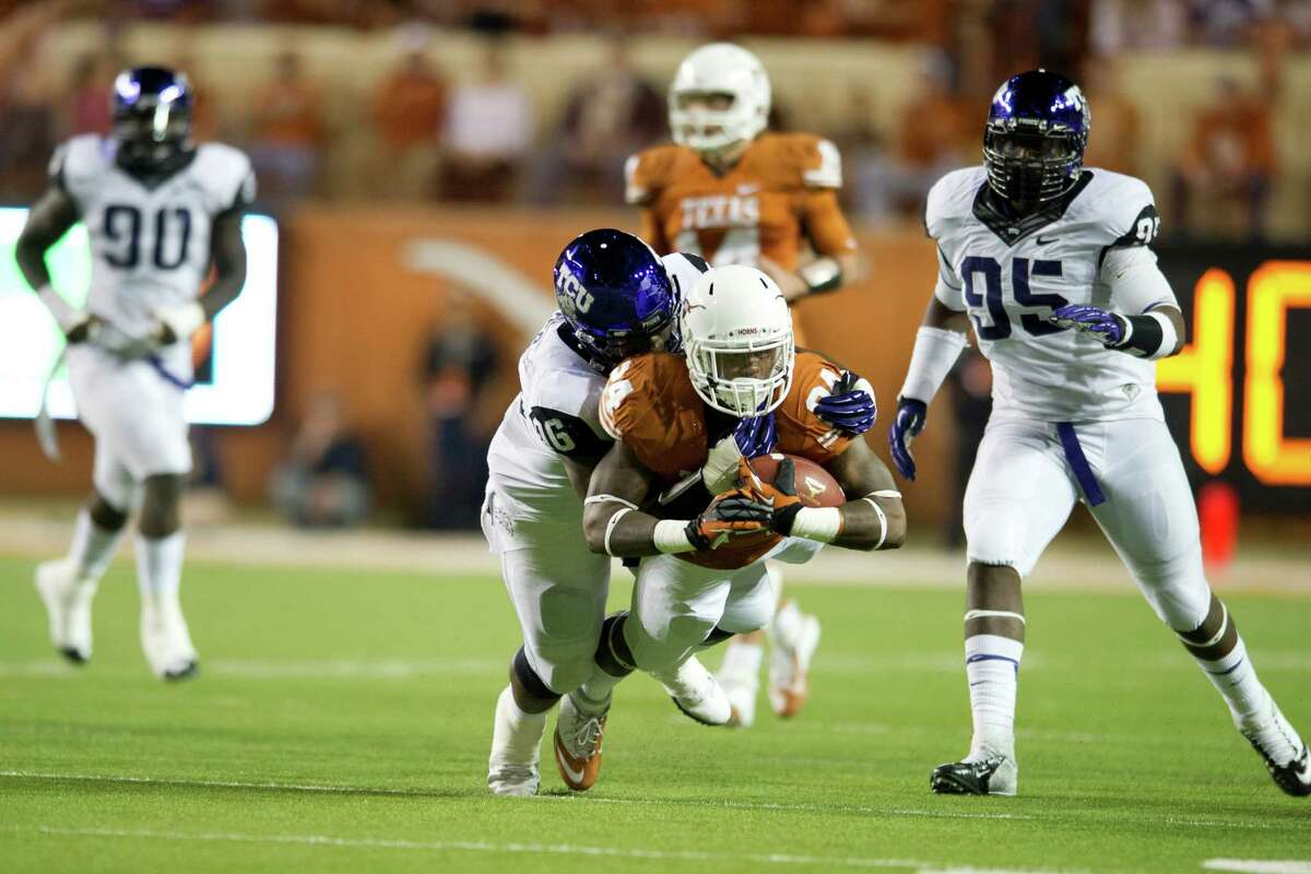 Joe Bergeron #24 of the Texas Longhorns dives for extra yards against the TCU Horned Frogs on November 22, 2012 at Darrell K Royal-Texas Memorial Stadium in Austin, Texas.
