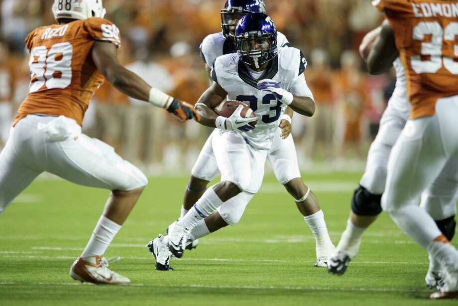 B.J. Catalon #23 of the TCU Horned Frogs breaks free against the Texas Longhorns on November 22, 2012 at Darrell K Royal-Texas Memorial Stadium in Austin, Texas. Photo: Cooper Neill, Getty Images / 2012 Getty Images