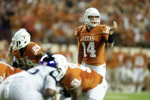 David Ash #14 of the Texas Longhorns calls a play at the line of scrimmage against the TCU Horned Frogs on November 22, 2012 at Darrell K Royal-Texas Memorial Stadium in Austin, Texas. Photo: Cooper Neill, Getty Images / 2012 Getty Images