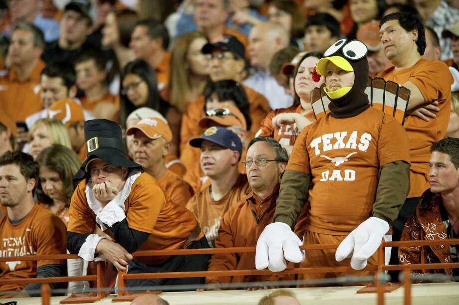 Fans of the Texas Longhorns look on as their team is down 14-3 at half time against the TCU Horned Frogs on November 22, 2012 at Darrell K Royal-Texas Memorial Stadium in Austin, Texas. Photo: Cooper Neill, Getty Images / 2012 Getty Images