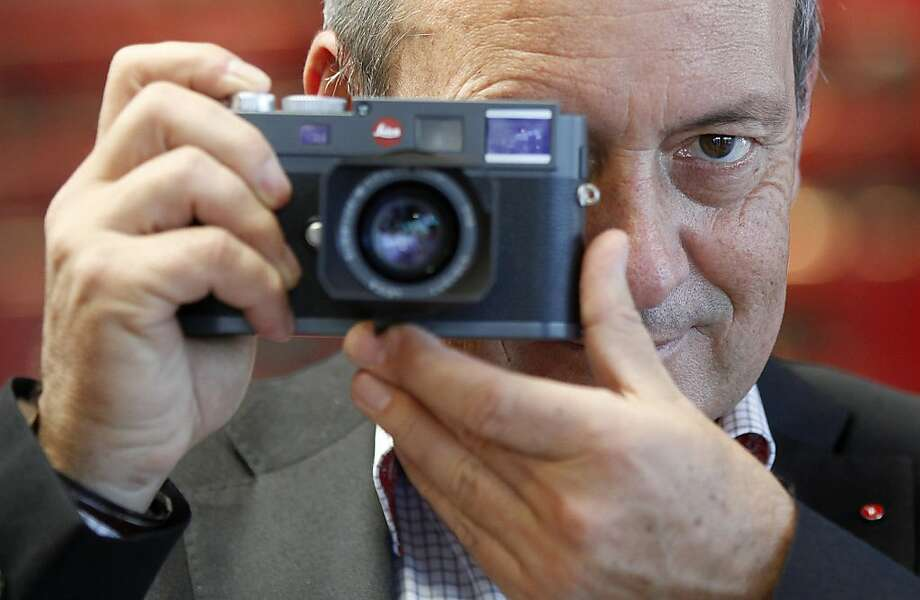 Alfred Schopf, chief executive officer of Leica Cameras AG, poses for a photograph with a Leica M series digital camera at the company's headquarters in Solms, Germany, on Wednesday, Oct. 31, 2012. Leica's compact cameras, introduced in the 1920s were developed by German optical engineer Oskar Barnack, who had worked in microscope research and was employed by an optician called Ernst Leitz in Wetzlar, Germany. Photographer: Simon Dawson/Bloomberg *** Local Caption *** Alfred Schopf Photo: Simon Dawson, Bloomberg