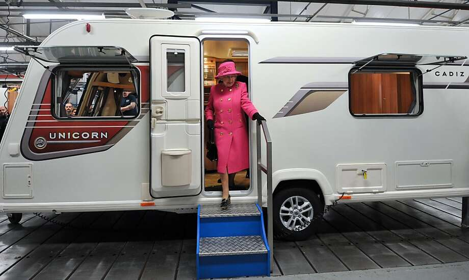 Britain's Queen Elizabeth II steps out of a motorhome during a visit to the Bailey caravan factory in Bristol on November 22, 2012. AFP PHOTO / POOL/ CARL COURTCARL COURT/AFP/Getty Images Photo: Carl Court, AFP/Getty Images