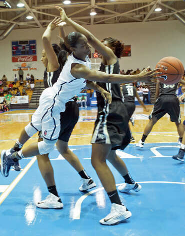 Connecticut's guard Brianna Banks, center, passes the ball to a teammate during the second half of an NCAA women's college basketball game against Wake Forest in St. Thomas, U.S. Virgin Islands, Thursday, Nov. 22, 2012. Connecticut won 95-34. (AP Photo/Thomas Layer) Photo: Thomas Layer, Associated Press / AP