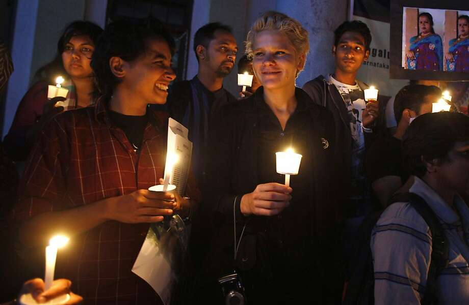 Members and supporters of the transgender community participate in a candlelight vigil on the first day of Bengaluru Pride and Karnataka Queer Habba (festival) in remembrance of those from their community who died the past year, in Bangalore, India, Wednesday, Nov. 22, 2012. The vigil was also held to protest daily harassment, violence and discrimination faced by the gay, lesbian, bisexual, inter-sex and transgender community. (AP Photo/Aijaz Rahi) Photo: Aijaz Rahi, Associated Press