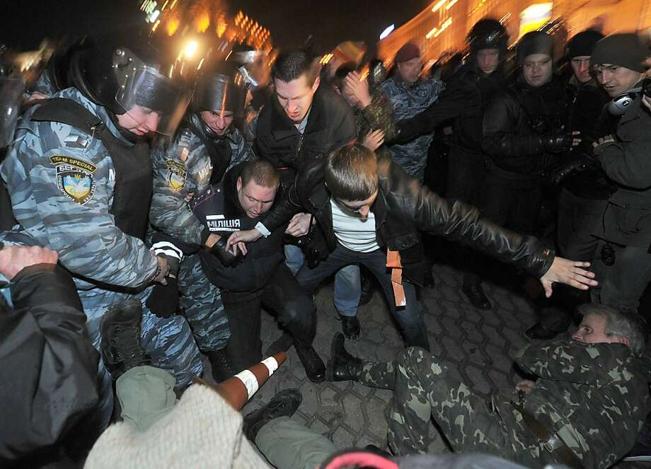 Opposition supporters scuffle with riot police during a rally marking the 8th anniversary of the Orange revolution in Kiev on November 22, *2012. AFP PHOTO/GENYA SAVILOVGENYA SAVILOV/AFP/Getty Images Photo: Genya Savilov, AFP/Getty Images