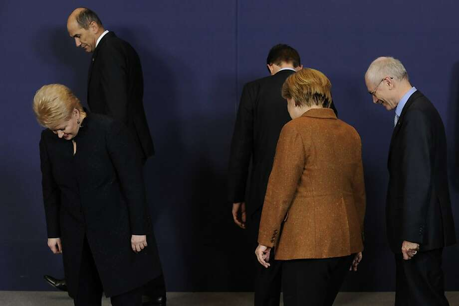 European leaders get ready to pose for a picture at the EU Headquarters on November 22, 2012 in Brussels, during a two-day European Union leaders summit called to agree a hotly-contested trillion-euro budget through 2020. European Union officials were scrambling to find an all but impossible compromise on the 2014-2020 budget that could successfully move richer nations looking for cutbacks closer to poorer ones who look to Brussels to prop up hard-hit industries and regions.                 AFP PHOTO / JOHN THYSJOHN THYS/AFP/Getty Images Photo: John Thys, AFP/Getty Images