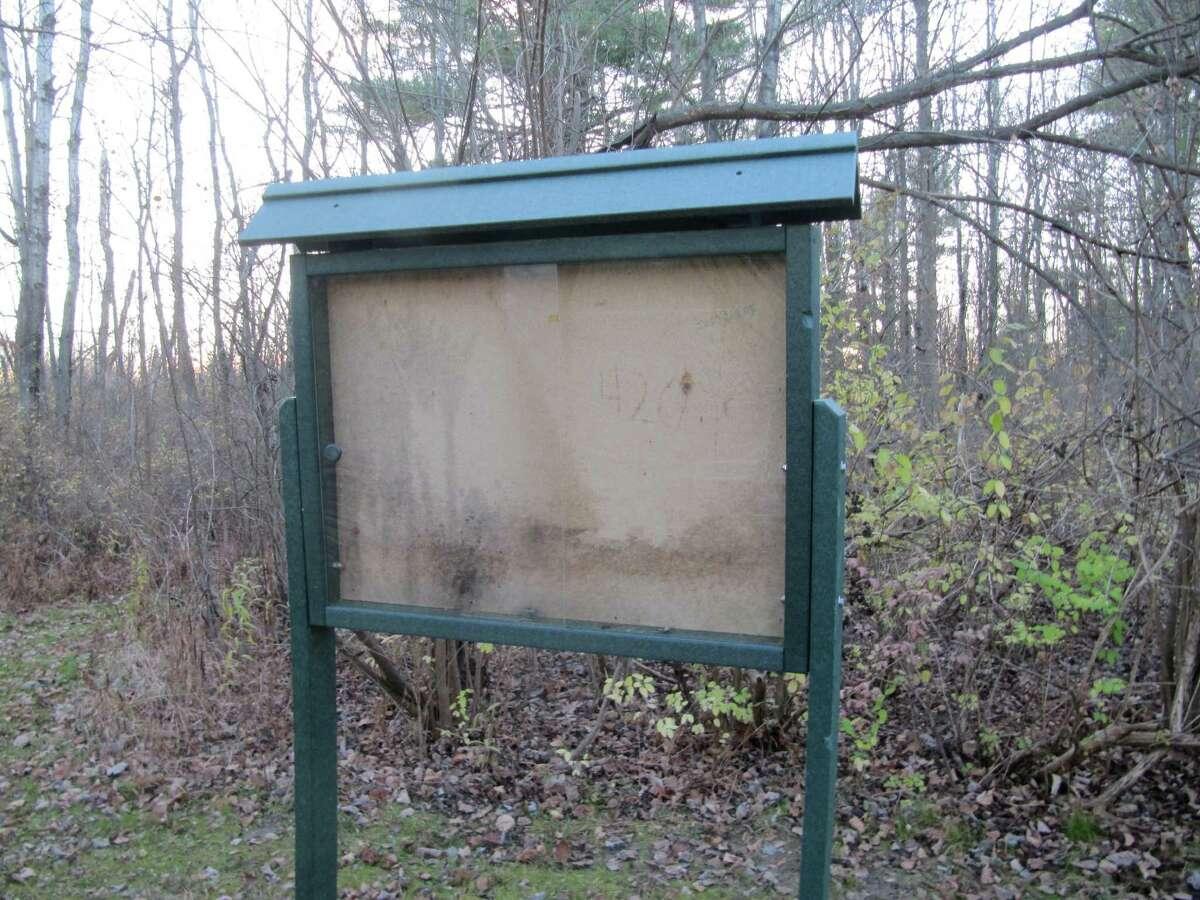 Photo by Gillian Scott. An empty informational kiosk near the Whitmyer Drive entrance to Mohawk River State Park.
