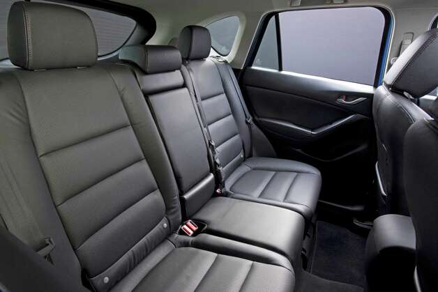 There is space under the front seats for rear passengers to put their feet, which is atypical. Photo: David Dewhurst, Mazda North American Operations / Copyright 2011