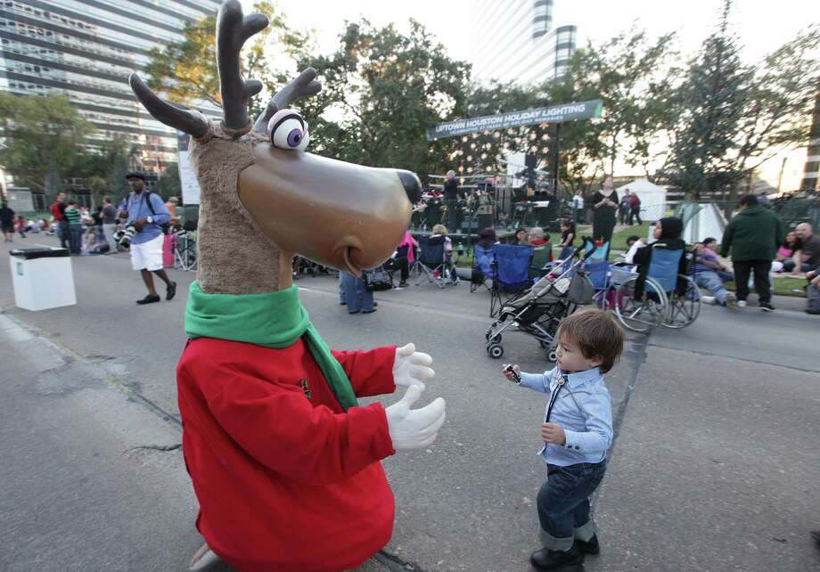 Satoshi Bagge, 1, runs towards the reindeer during The 27th Annual Uptown Houston Holiday Lighting Celebration on Thursday, Nov. 22, 2012, in Houston. Photo: Mayra Beltran, Houston Chronicle / © 2012 Houston Chronicle