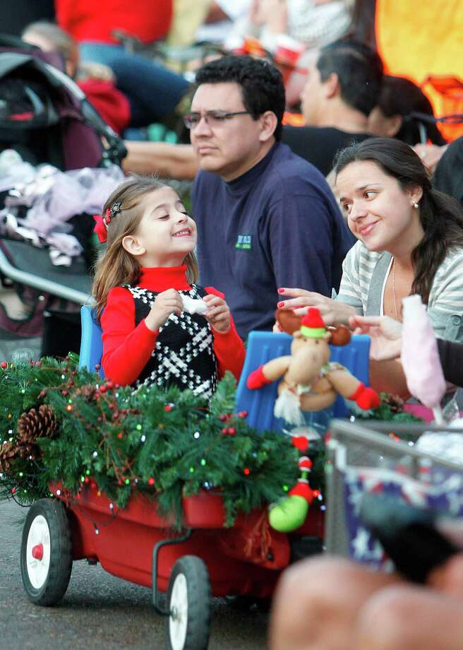 Bryanna Micu, 5, smiles to Diana Guzman, as they patiently wait for the fireworks show during The 27th Annual Uptown Houston Holiday Lighting Celebration on Thursday, Nov. 22, 2012, in Houston. Photo: Mayra Beltran, Houston Chronicle / © 2012 Houston Chronicle