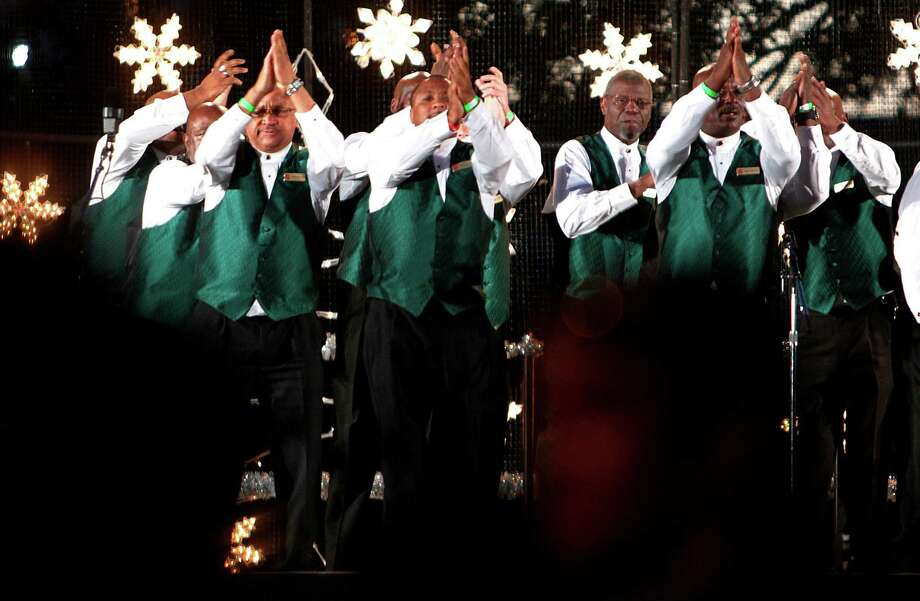 A choir performs during The 27th Annual Uptown Houston Holiday Lighting Celebration on Thursday, Nov. 22, 2012, in Houston. Photo: Mayra Beltran, Houston Chronicle / © 2012 Houston Chronicle