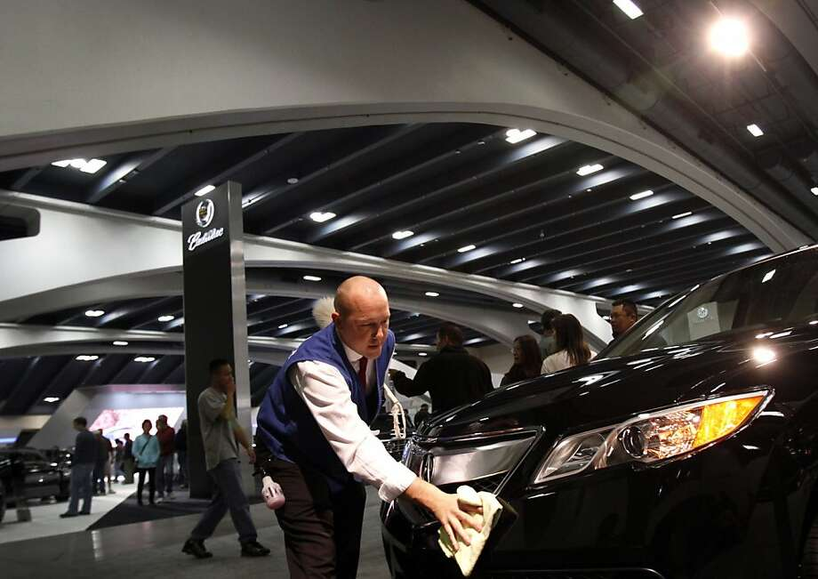 Tim Harris, of Cosmetic Car Care, polishes the Acura RDX at opening day of the 55th San Francisco International Auto Show in San Francisco, Calif., Thursday, November 22, 2012. Photo: Sarah Rice, Special To The Chronicle